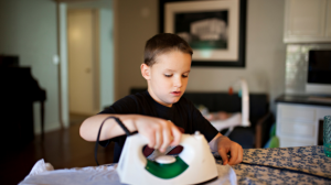 young boy ironing